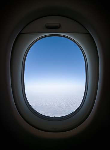 window clear white skies from plane's window view porthole