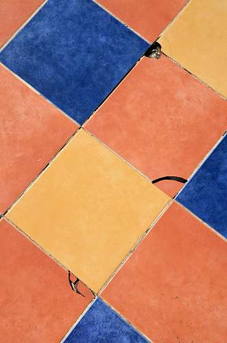 photo texture close-up photography of blue, orange, and yellow tile surface pattern free for commercial use images