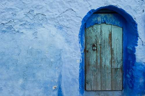 door close-up photography of concrete house chefchaouen