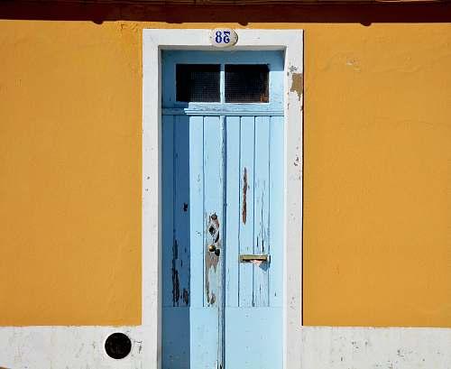 yellow closed blue wooden door door