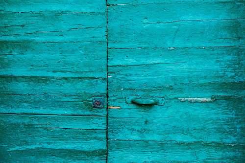 riomaggiore closed teal wooden door italy