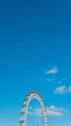 london Ferris wheel during day amusement park