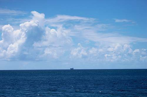 nature gray cruiser ship in the middle of ocean outdoors