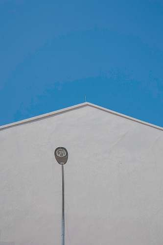 building gray outdoor lamp post near white concrete building during daytime architecture