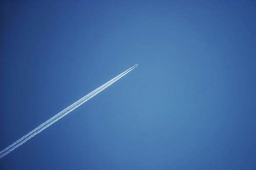 nature jet plane in the sky during daytime sky