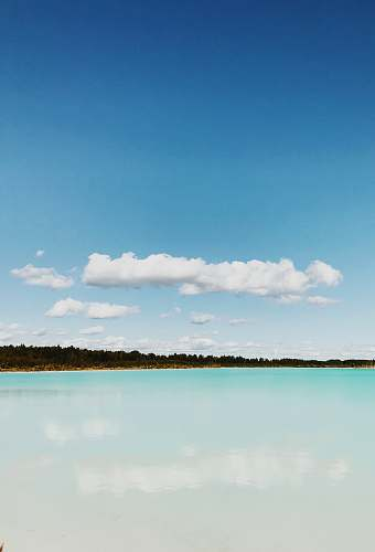 cloud landscape photo of island under cloudy sky ocean