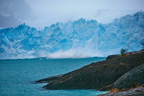 glacier landscape photography of ice burg ice