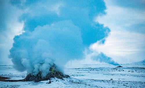 geyser landscape photography of rock bursting smoke nature