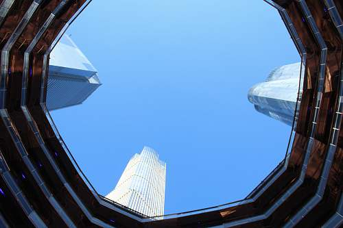 window low angle photo of buildings new york