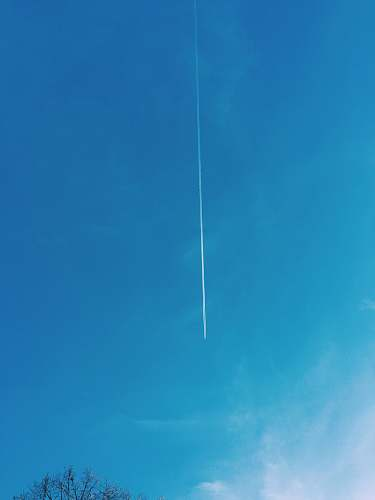 sky low angle view of plane contrail nature