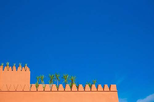 architecture lowangle photo of brown concrete wall during daytime morocco