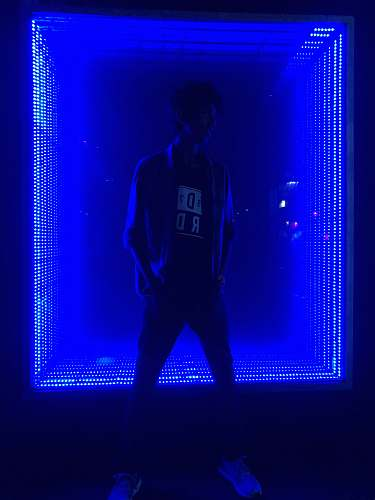 person man standing in front of light human