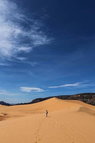 desert man standing on desert dune