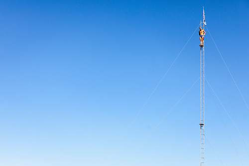 antenna man wearing blue brief standing ladder electrical device
