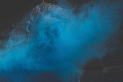 smoke man's face covered with smoke person