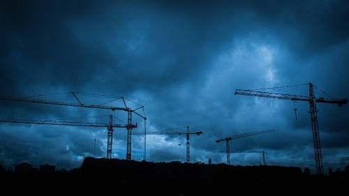 tübingen metal crane towers during cloudy day germany