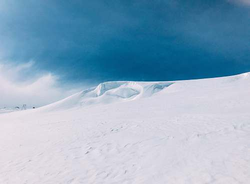 mountain mountain covered by snow snow