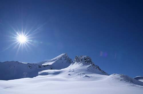 mountain mountain covered with snow alps