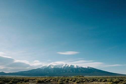 colorado mountain near grass field under cloudy sky field