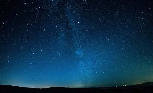 astronomy mountains under starry sky galaxy