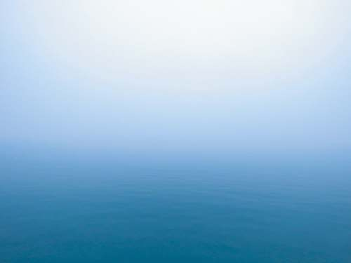 nature ocean water during fog sky