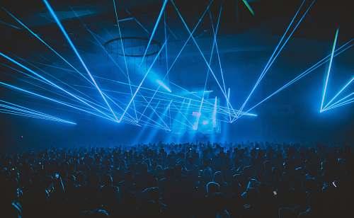 light people partying under blue lights laser