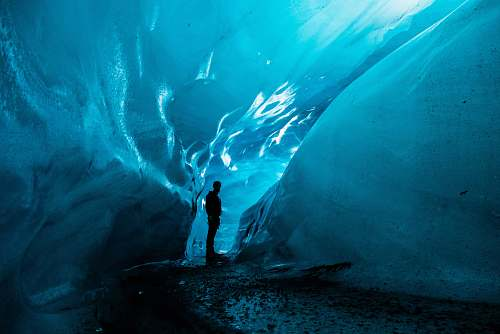 nature person standing in ice cave at daytime iceland