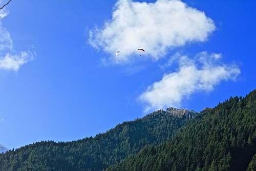 cloud person using parachute landscape