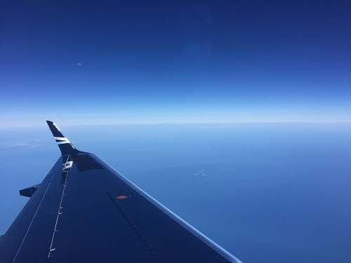 sky photo of black airplane wing nature