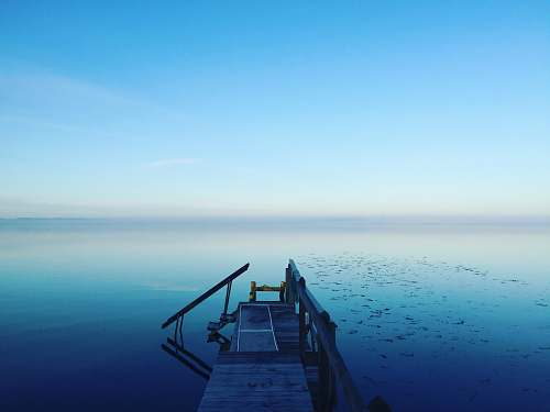 water photography of calm body of water horizon
