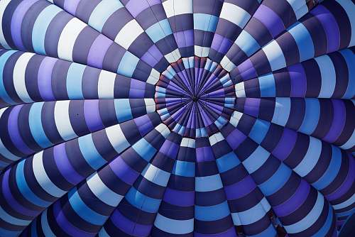 background purple, sky-blue, white, and black stripe textile hot air balloon
