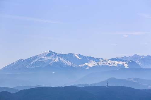 mountain snow capped mountain under clear sky mountain range