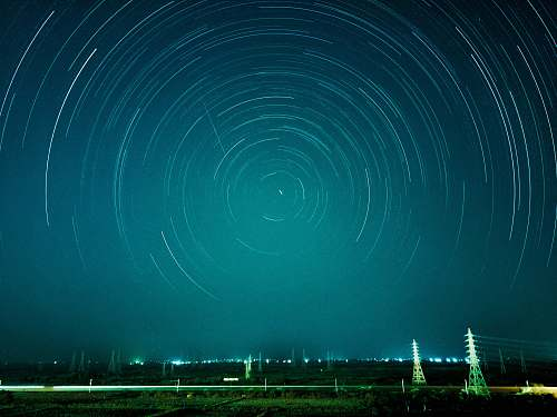 teal time-lapse photograph of stars night