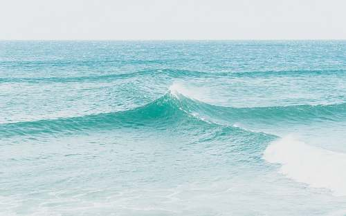 ocean time lapse photography of ocean wave water