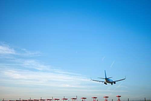 airplane white airplane flying during daytime transportation