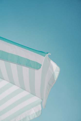 teal white and green striped parasol during daytime photo summer