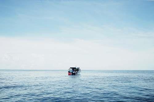 boat white and orange pontoon boat water