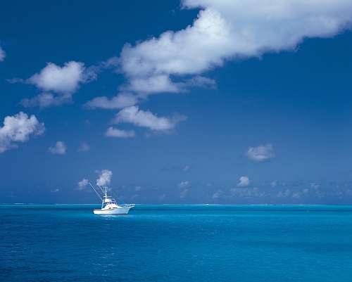 ocean white boat on sea under cloudy sky sea