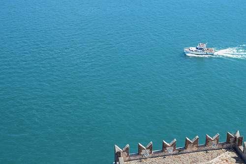 ocean white motor boat sailing on ocean during daytime sea