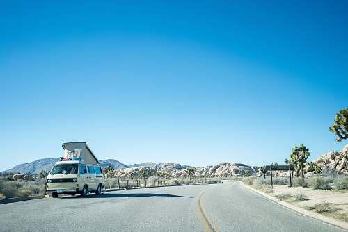 van white van on road during daytime vehicle