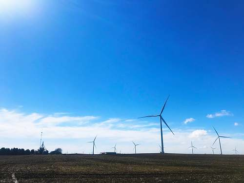 photo engine wind mills under blue sky motor free for commercial use images