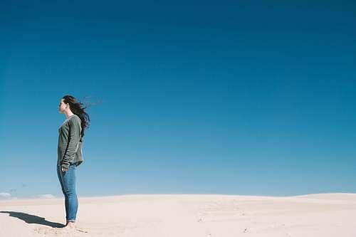 human woman standing on gray sand people