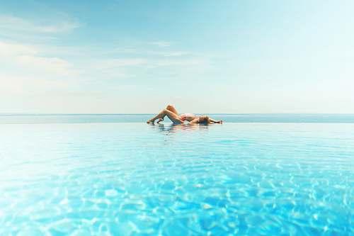 ocean woman sun bathing on beach water