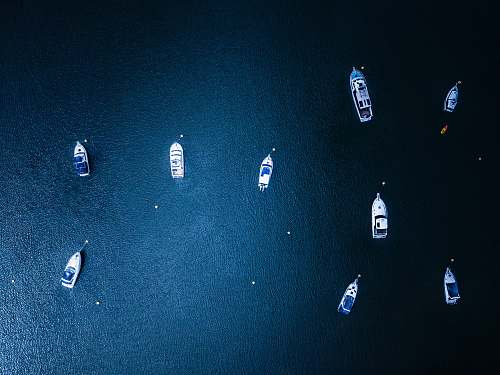 astronomy yachts on body of water during daytime galaxy