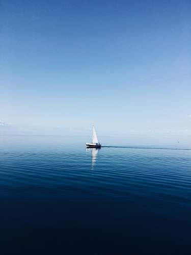 vehicle white sailboat at middle of ocean transportation