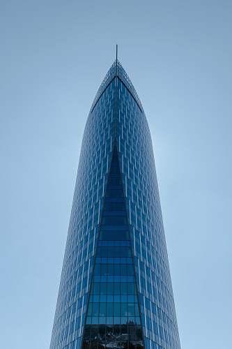 city blue glass building high rise