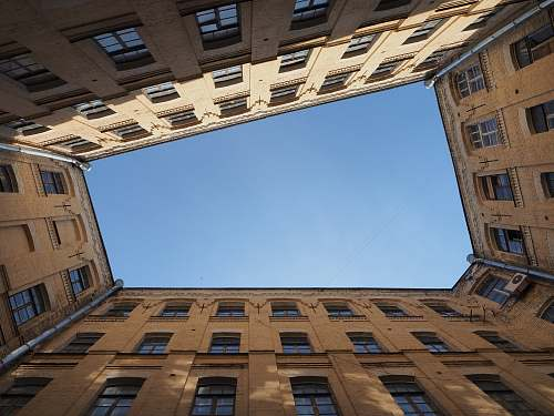 architecture low angle photography of building under clear sky window