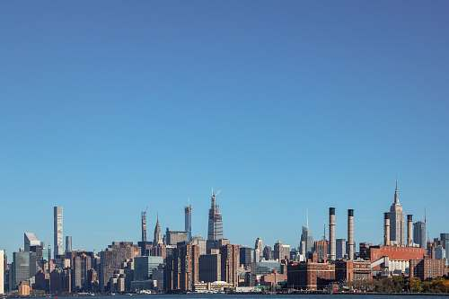 urban panoramic photography of high-rise buildings under clear blue sky building
