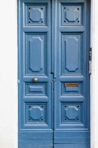 blue brown wooden paneled doors rome