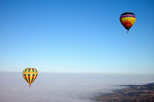 photo blue two hot air balloons flying over sky aircraft free for commercial use images